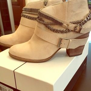 Edgy, multi-chain Dolce Vita booties